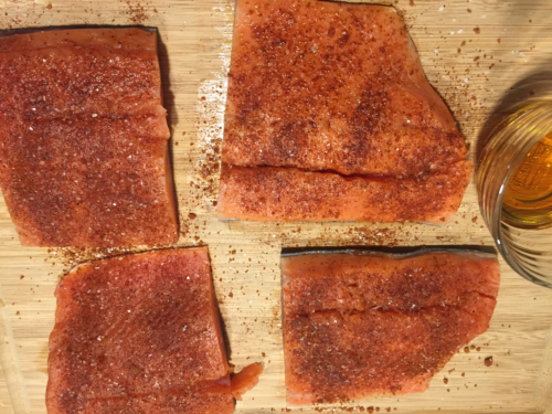 Rub spices evenly over the flesh side of the fish - about a teaspoon of spices per filet.