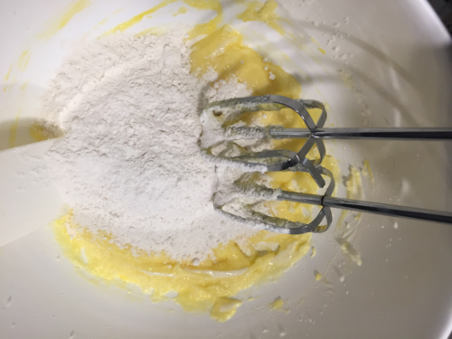 In a medium bowl, mix together the flour, salt, baking powder and baking soda.  Add half of that mixture to the creamed butter/sugar.